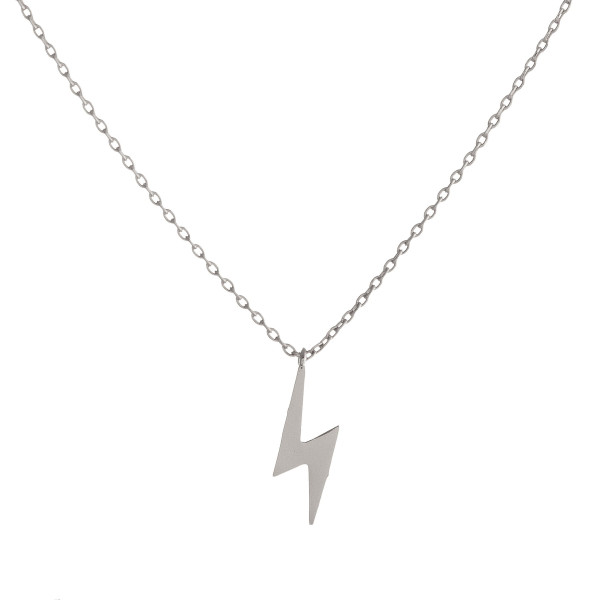 "Dainty cable chain necklace featuring a lightening bolt pendant. Pendant approximately 1.5 cm. Approximately 16"" in length overall."