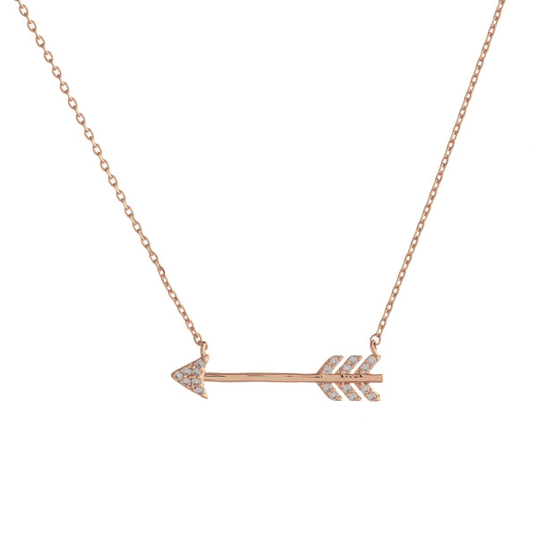 "Dainty cable chain necklace featuring a arrow pendant with cubic zirconia details. Pendant approximately 1"". Approximately 18"" in length overall."