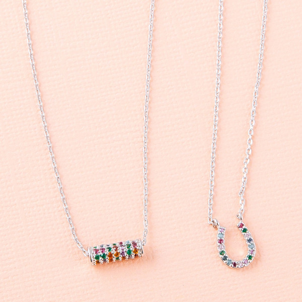 """Dainty cable chain necklace featuring a horseshoe pendant with multicolor cubic zirconia details. Pendant approximately 1cm. Approximately 18"""" in length overall."""