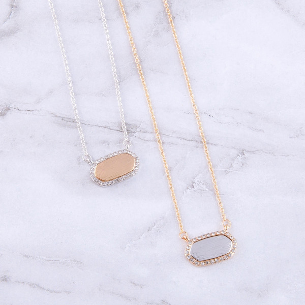 "Dainty cable chain necklace featuring a resin inspired bar pendant with cubic zirconia details. Pendant approximately .75"" wide. Approximately 16"" in length overall."