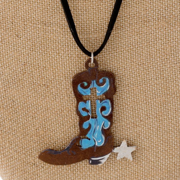 """Long black felt necklace featuring a metal boot pendant with a cross detail. Pendant approximately 3"""". Approximately 38"""" in length overall."""