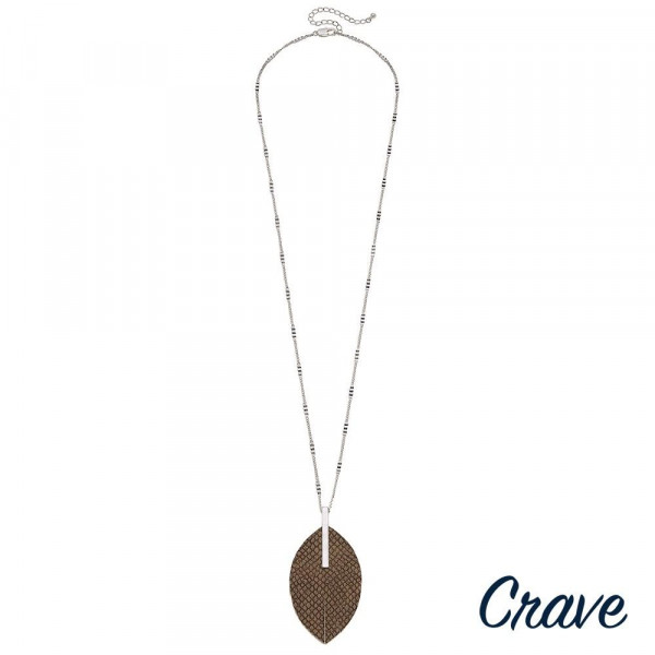 """Silver chain necklace featuring a faux leather feather pendant with snakeskin details and a silver metal bar accent. Pendant approximately 3.5"""". Approximately 36"""" in length overall."""