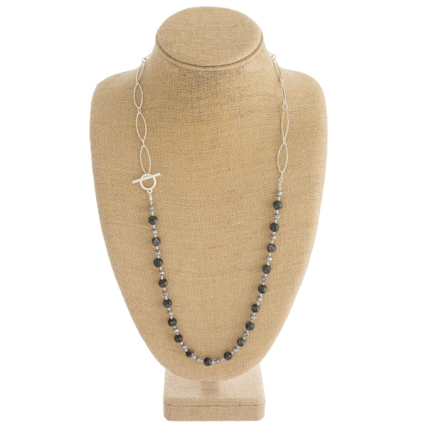 "Half chain link and natural stone beaded necklace with toggle clasp closure. Approximately 31"" in length."