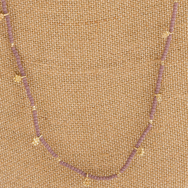 """Long dainty beaded flower accented necklace. Approximately 30"""" in length."""