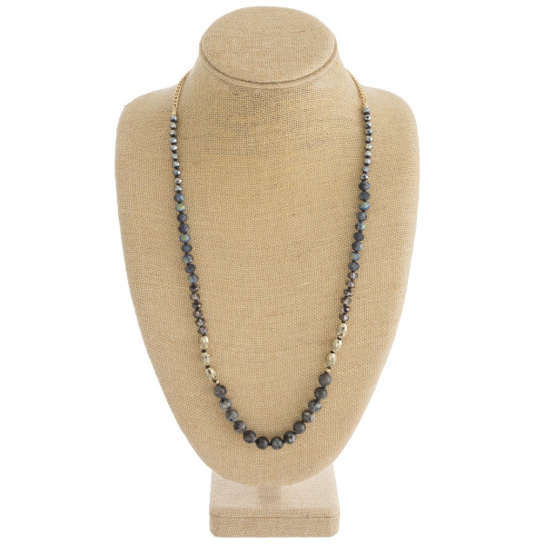"Natural stone beaded necklace with faceted bead details. Approximately 32"" in length."
