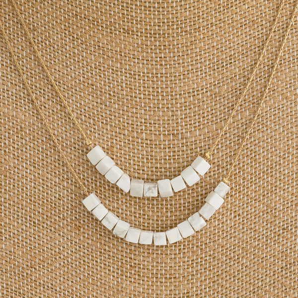 "Dainty double layered necklace with natural stone block beaded details. Approximately 16"" in length."