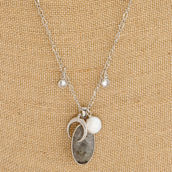 """Long semi precious necklace featuring crescent and pearl charm accents. Pendant approximately 1"""" in length. Approximately 30"""" in length overall."""