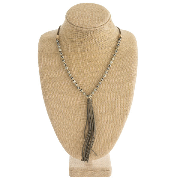 """Faux leather natural stone beaded tassel necklace with adjustable bolo closure. Approximately 38"""" in length."""