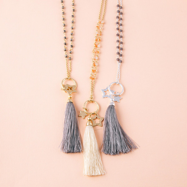 """Long cable chain necklace featuring a trio pendant with tassel and star accents and faceted beaded details. Pendant approximately 4"""". Approximately 38"""" in length overall."""