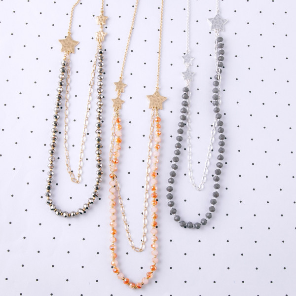 """Long cable chain necklace featuring a layered bottom half with faceted beaded details and star accents. Approximately 34"""" in length."""