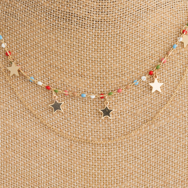 "Dainty layered seed beaded necklace with star accents. Approximately 16"" in length."