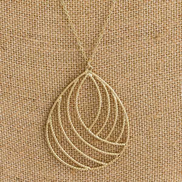 """Long cable chain necklace featuring a twisted texturized teardrop pendant. Pendant approximately 2.5"""". Approximately 34"""" in length overall."""