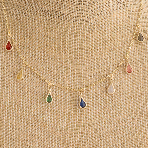 """Cable chain necklace featuring multicolor crystal/rhinestone teardrop accents. Approximately 16"""" in length."""