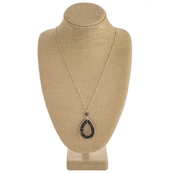 "Long link bar chain necklace featuring a double teardrop pendant with rhinestone details. Pendant approximately 2.5"". Approximately 36"" in length overall."