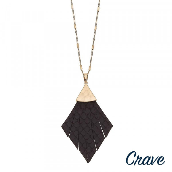 "Long link bar chain necklace featuring a faux leather snakeskin feather pendant. Pendant approximately 3"". Approximately 36"" in length overall."