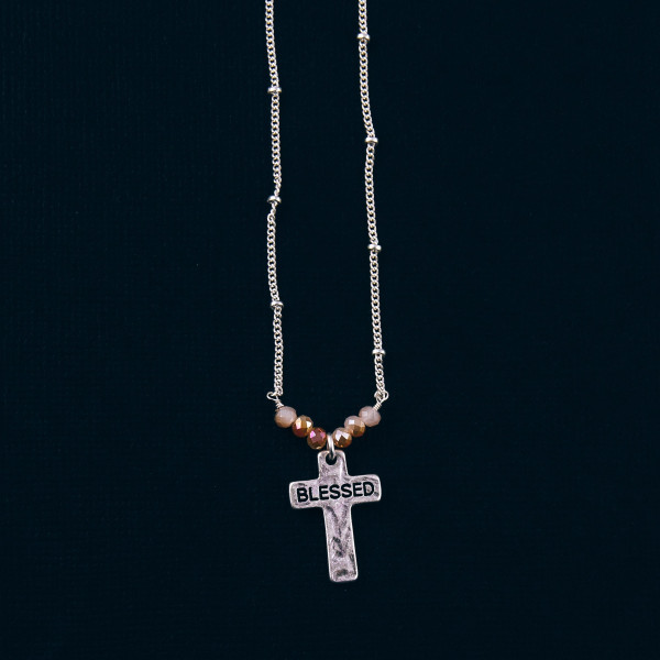 """Silver satellite chain hammered """"Blessed"""" engraved cross pendant necklace featuring beaded accents. Pendant approximately 1"""" in length. Approximately 16"""" in length overall."""