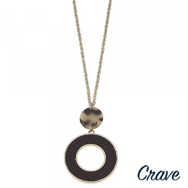 """Long rope chain necklace featuring a wood inspired round pendant with a resin disc accent. Pendant approximately 3"""" in length. Approximately 34"""" in length overall."""