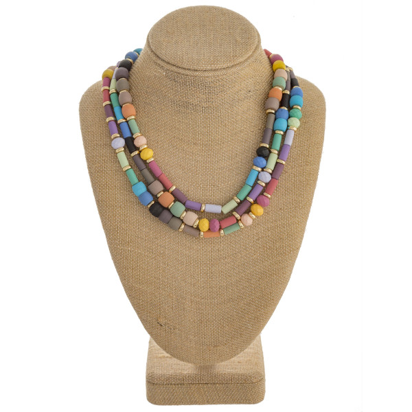 """Trio layered color block necklace with wood and faceted bead details. Approximately 16"""" in length."""