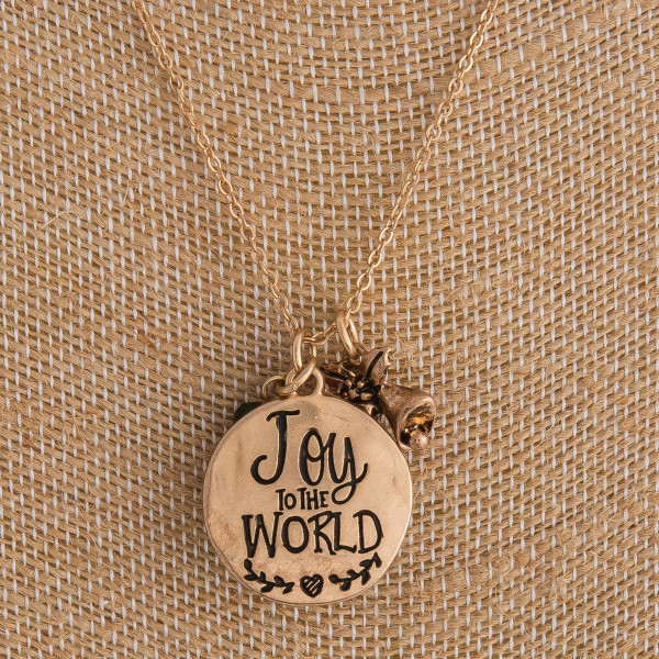 "Gold ""Joy to the World"" engraved Christmas charm necklace. Pendant approximately 1"" in diameter. Approximately 18"" in length overall."