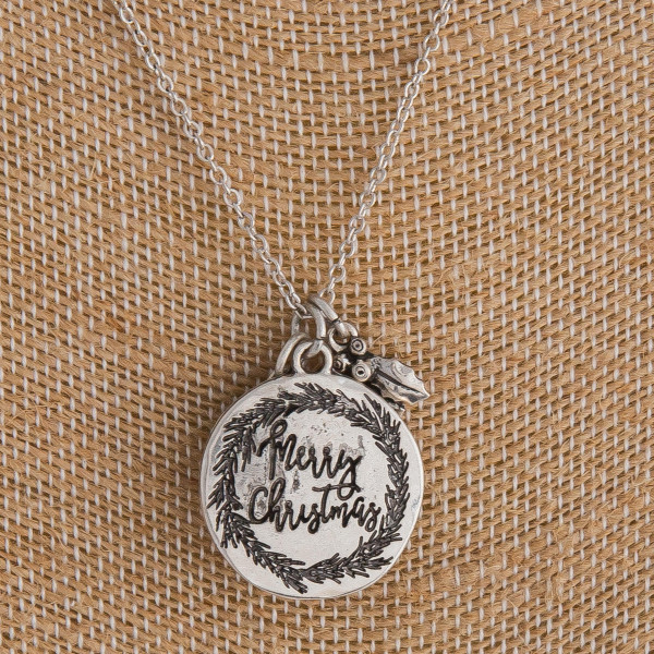 "Silver ""Merry Christmas"" engraved Christmas charm necklace. Pendant approximately 1"" in diameter. Approximately 18"" in length overall."