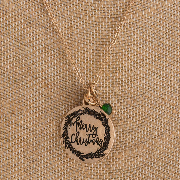 "Gold ""Merry Christmas"" engraved Christmas charm necklace. Pendant approximately 1"" in diameter. Approximately 18"" in length overall."