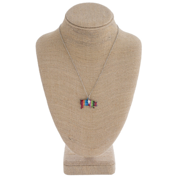 """Enamel coated serape pig pendant necklace with pearl accent. Pendant approximately 1"""" in length. Approximately 18"""" in length overall."""