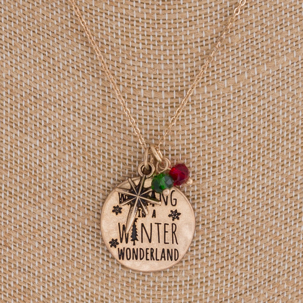 """""""Walking in Winter Wonderland"""" engraved pendant necklace. Pendant approximately 1"""" in diameter. Approximately 18"""" in length overall."""
