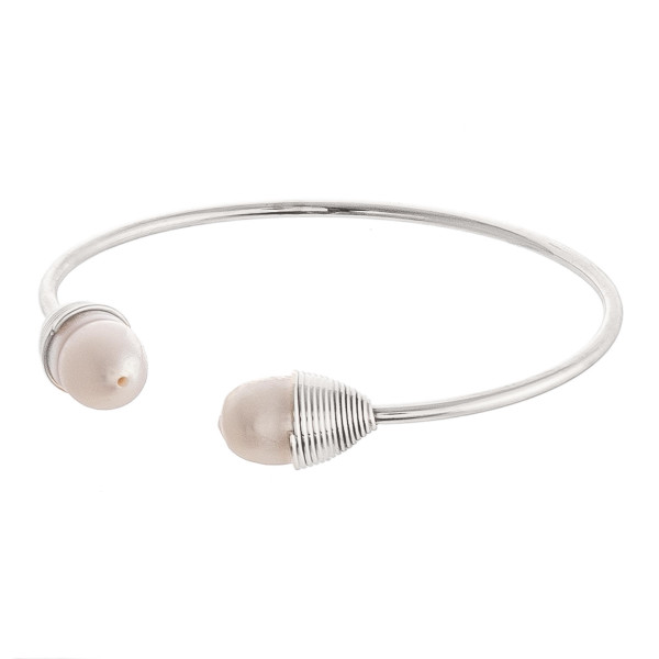 """Pearl cuff bracelet. Approximately 2.5"""" in diameter. Fits up to a 5"""" wrist."""