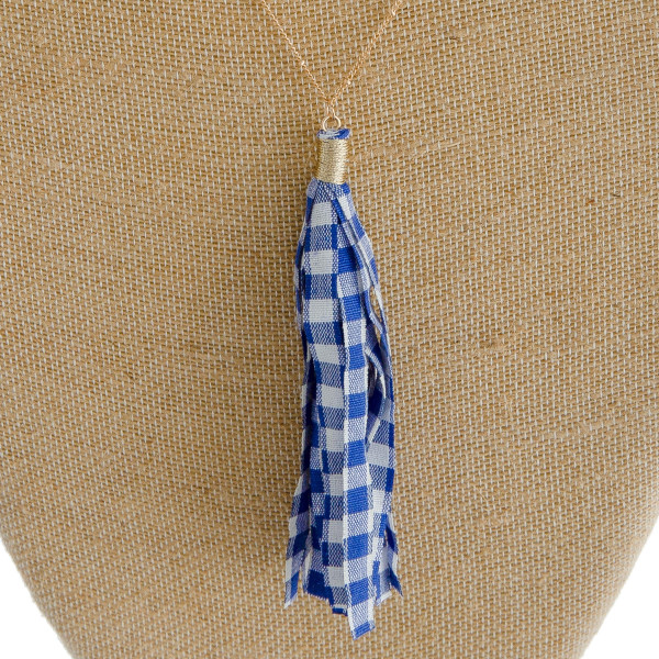 "Long satellite chain necklace featuring a fabric buffalo check tassel pendant. Pendant approximately 4.5"" in length. Approximately 38"" in length overall."