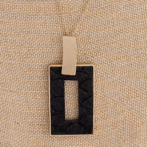 """Fur faux leather snakeskin metal square encased pendant. Pendant approximately 3"""" in length. Approximately 36"""" in length overall."""
