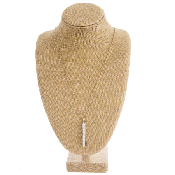 "Druzy metal encased bar pendant necklace. Pendant approximately 3"" in length. Approximately 34"" in length overall."