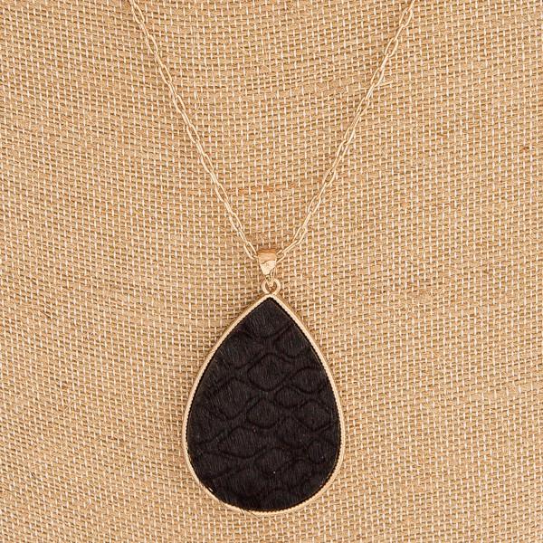 "Fur faux leather snakeskin metal encased teardrop pendant necklace. Pendant approximately 2"" in length. Approximately 36"" in length overall."