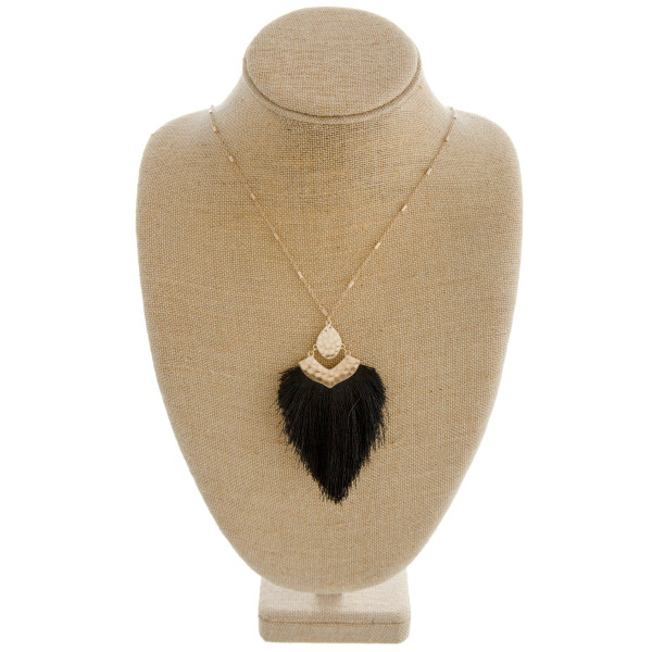 """Link bar necklace featuring a tassel pendant with hammered metal accents. Pendant approximately 4"""" in length. Approximately 38"""" in length overall."""