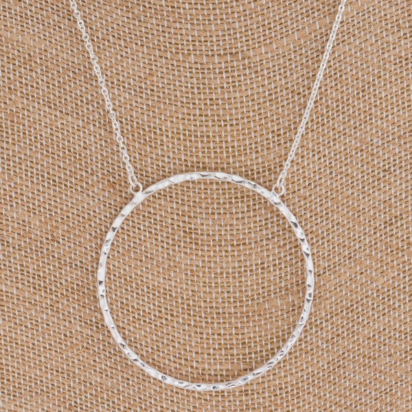 """Hammered open circle pendant necklace. Pendant approximately 2"""" in diameter. Approximately 18"""" in length overall."""