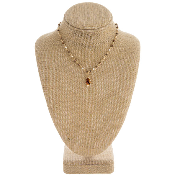 "Faceted beaded teardrop necklace with pearl accents. Approximately 16"" in length."