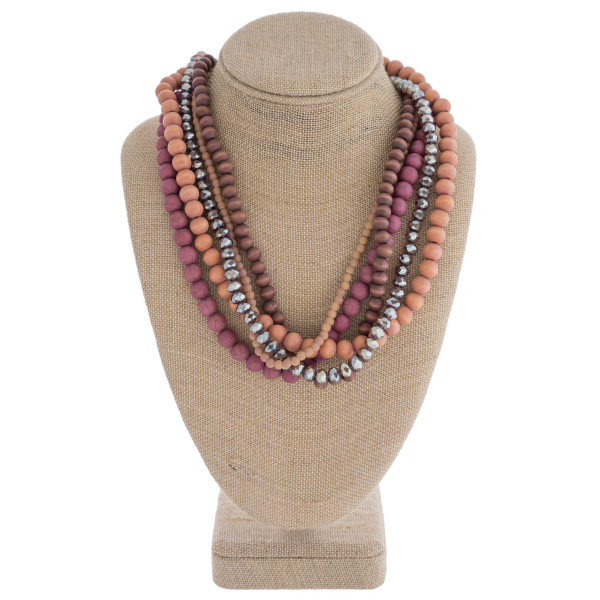 "Layered beaded statement necklace. Approximately 18"" in length."