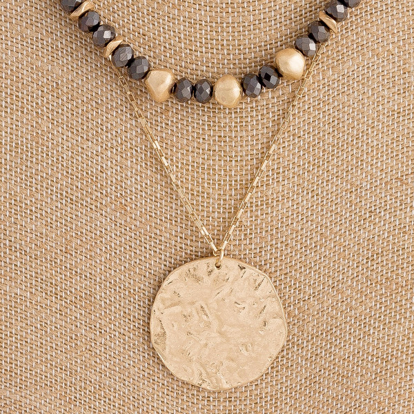 "Double layered necklace featuring hammered disc pendant and beaded details. Pendant approximately 1.5"" in diameter. Approximately 18"" in length overall."