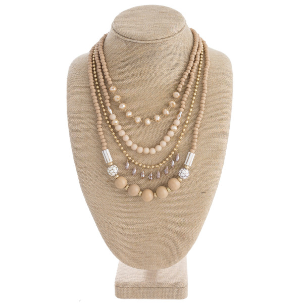 """Wood beaded layered teardrop chandelier necklace with glass bead details. Approximately 22"""" in length."""