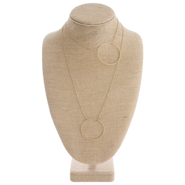 "Modern design double-layered necklace with asymmetrical circle pendants. Style falls off-center. Shortest layer approximately 16"", approximately 28"" in length overall."