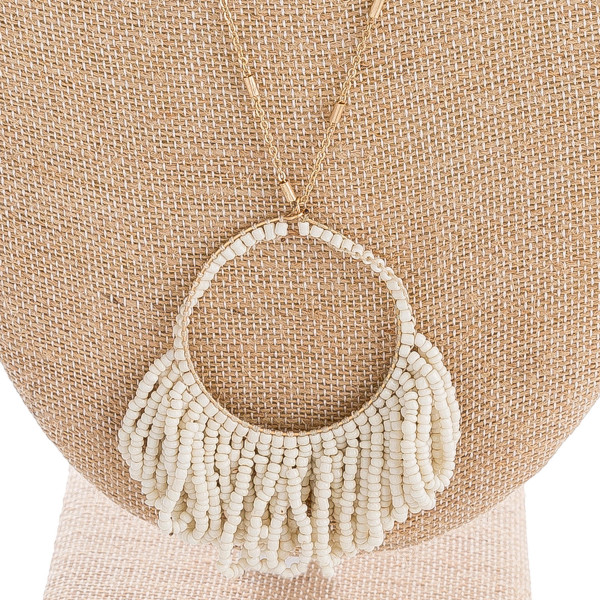 """Link bar chain necklace with seed beaded tassel pendant. Pendant approximately 3"""" in length. Approximately 36"""" in length overall."""