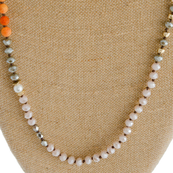 """Long semi precious beaded necklace. Approximately 38"""" in length."""