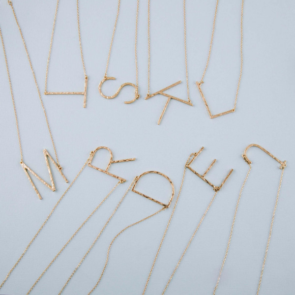 "Hammered initial ""L"" necklace. Pendant approximately 1.75"" in length. Approximately 18"" in length overall."