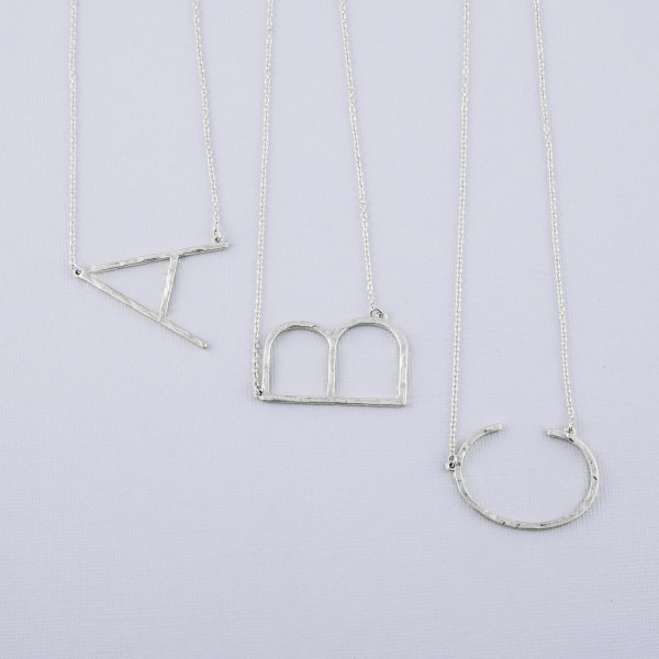 """Hammered initial """"A"""" necklace. Pendant approximately 1.75"""" in length. Approximately 18"""" in length overall."""