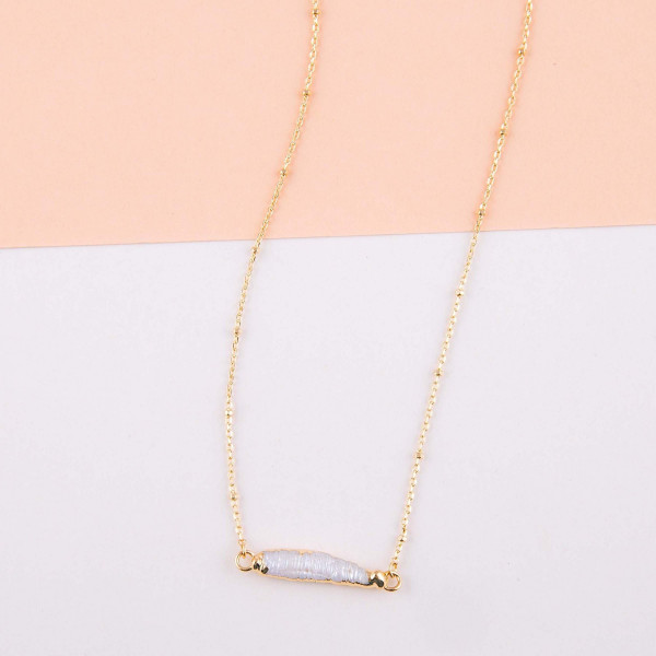 "Satellite chain faux pearl bar necklace. Pendant approximately 1"" in length. Approximately 16"" in length overall."