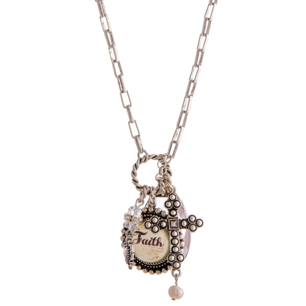 """Chain linked charm pendant necklace featuring round dome """"Faith"""" illustration details. Pendant approximately 2"""" in length. Approximately 34"""" in length overall."""