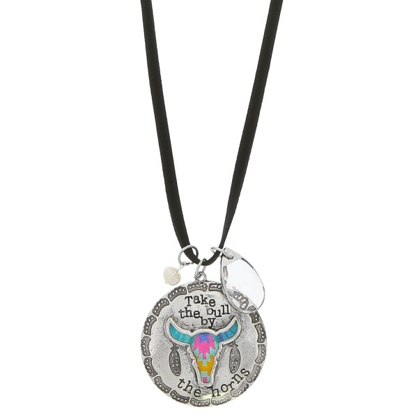 """Black faux leather necklace featuring an antique silver bull pendant with """"Take the bull by the horns"""" engraved details and crystal accent.  - Pendant approximately 2.25"""" in diameter - Approximately 38"""" in length overall with 3.5"""" extender"""