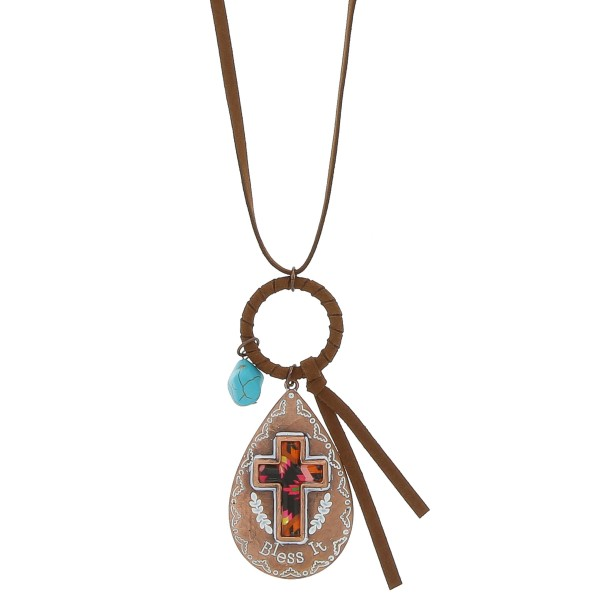 """Light Brown faux leather necklace featuring a copper tone teardrop cross pendant with """"Bless It"""" engraved details and natural stone accent.  - Pendant approximately 3"""" in length - Approximately 38"""" in length overall with 3.5"""" extender"""