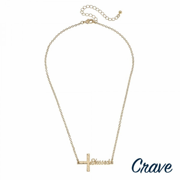 """Gold cable chain east west cross """"Blessed"""" script necklace. Pendant approximately 1.5"""" in length. Approximately 16"""" in length overall."""