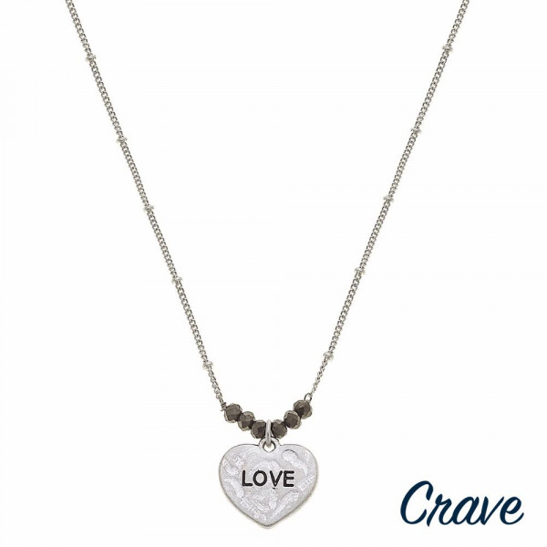 """Silver satellite chain hammered """"Love"""" engraved heart pendant necklace featuring beaded accents. Pendant approximately .5"""" in diameter. Approximately 16"""" in length overall."""