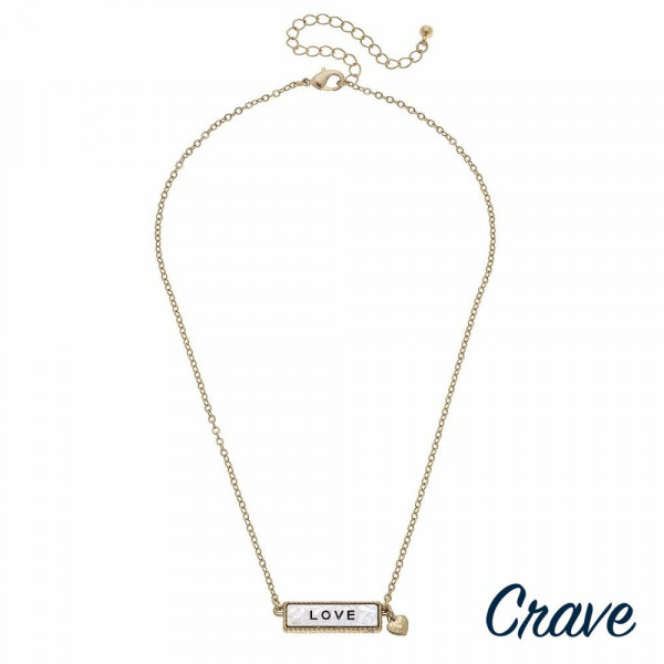 """Gold cable chain """"Love"""" engraved two tone reversible bar pendant necklace. Pendant approximately 1"""" in length. Approximately 16"""" in length overall."""